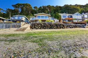 32559811 - luxury houses with exit to private beach. rock wall with dock