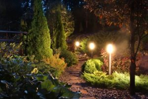 31372345 - illuminated home garden path patio lights and plants in evening dusk